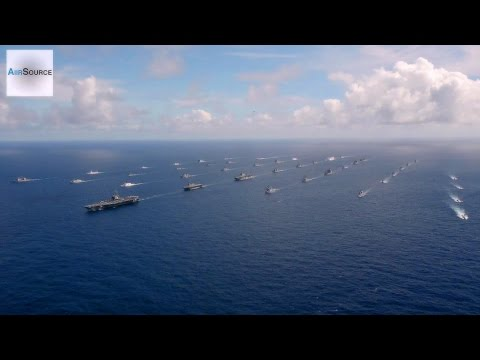 Exercise - Forty-two ships and submarines representing 15 international partner nations steam in a close formation during Rim of the Pacific (RIMPAC) Exercise 2014. Twenty-two nations, 49 ships and six...