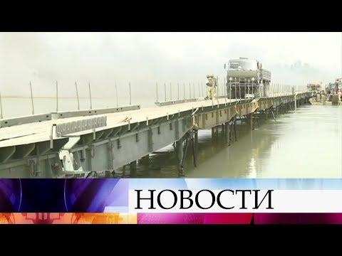 Российские военные вСирии вкратчайшие сроки построили мост через реку Ефрат врайоне Дейр-эз-Зора