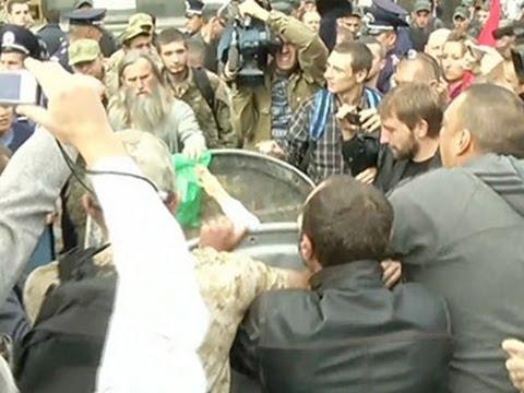 bin - Subscribe for more Breaking News: http://smarturl.it/AssociatedPress Ukrainian activists threw a member of parliament Vitaliy Zhuravskyi into a trash bin, near Kiev's parliamentary building...