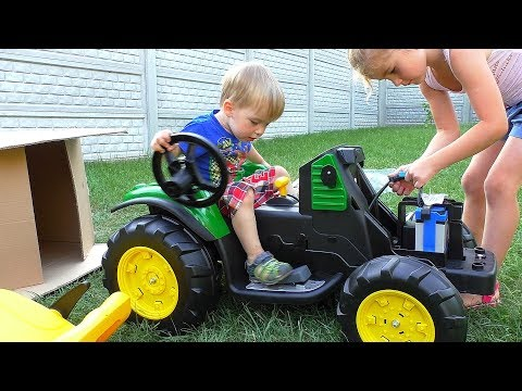 Melissa and baby Arthur unpack and assemble the tractor