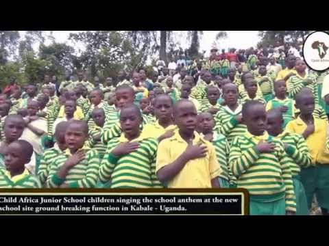 Child Africa Junior school singing the School Anthem at the ground breaking of new School