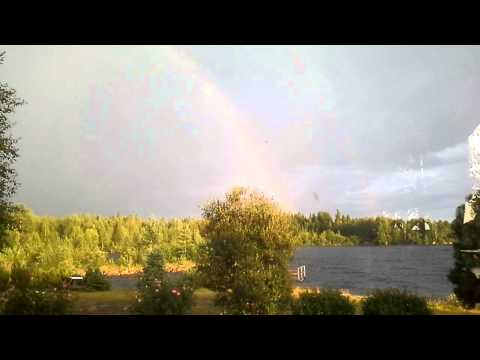A lady was filming a rainbow in a village nearby... when lightning struck