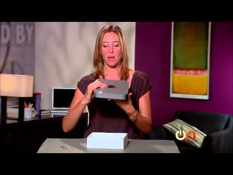 Mac Mini - http://cnet.com/alwayson Attention home-theater fans: Apple has updated its Mac Mini computer for the holidays. Molly Wood unboxes the 2012 model and gives h...