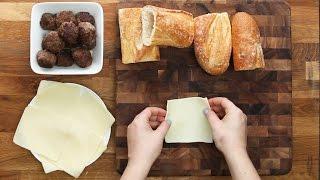 Meatball-Stuffed Garlic Bread by Tasty