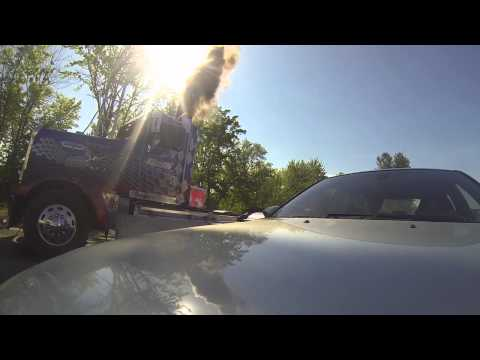 BMW M5 vs. Kenworth 900