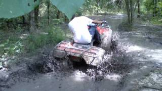 9. 2002 Honda Rancher and 2003 Yamaha Grizzly 660 mudding