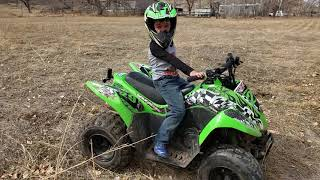 4. 6 year old riding kawasaki  kfx 90 quad ATV - popping wheelies