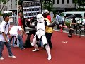 Danny Choo clad in a Stormtrooper costume terrorizing the demonstrators with his new found attachments.