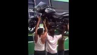 Guy With Super Strength Puts Motorcycle On Roof Of A Bus With His Head