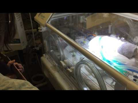 Man gets a chance to sing to newborn son before he passes away.