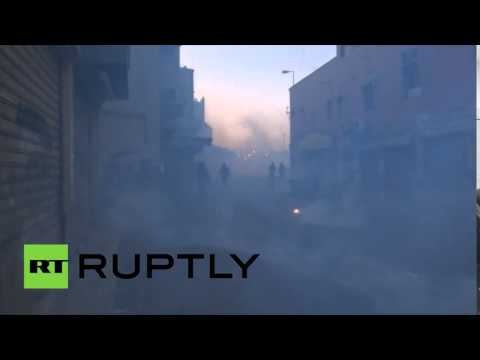 Protesters choke streets with smoke in Bahrain