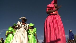 Layers of petticoats, puffed-up sleeves, embroidered blouses and horn-shaped hats... the traditional Herero dress marks a ...
