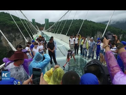Volunteers Sledgehammer The Crap Out Of A Glass Bridge To Prove Its