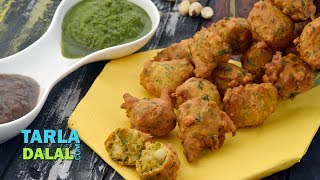 """Peanut Pakoda,Recipe Link : https://www.tarladalal.com/Peanut-Pakoda-Shingdana-Bhajiya-789rSubscribe : http://goo.gl/omhUioTarla Dalal App: http://www.tarladalal.com/free-recipe-app.aspxFacebook: http://www.facebook.com/pages/TarlaDalal/207464147348YouTube Channel: http://www.youtube.com/user/TarlaDalalsKitchen/featuredPinterest: http://www.pinterest.com/tarladalal/Google Plus:  https://plus.google.com/107883620848727803776Twitter: https://twitter.com/Tarla_DalalPeanut PakodaHot, crunchy, spicy pakodas perfect for the monsoon! The Peanut Pakoda is made with a batter of besan, whole wheat flour and crushed peanuts along with chopped spinach and spice powders, in proportions that give it a wonderfully crispy texture and totally irresistible flavour. Served with sweet chutney and green chutney, these Peanut Pakodas are like a dream come true, and the only reaction you can expect from your family and friends is: """"More, Please!"""" Serve with a cup of Elaichi Tea or coffee.Preparation Time: 15 minutes.Cooking Time: 20 minutes.Serves 4. ¾ cup roasted and coarsely crushed peanuts¾ cup besan (Bengal gram flour)½ cup whole wheat flour (gehun ka atta)¾ cup shredded spinach (palak)1 tbsp warm oil1½ tbsp finely chopped green chillies1 tbsp lemon juice¼tsp baking soda½ tsp chilli powder¼ tsp garam masalaSalt to tasteOil for deep-fryingFor servingGreen chutneySweet chutney1. Combine all the ingredients along with approx. ½ cup of water in a deep bowl and mix well.2. Heat the oil in a deep non-stick pan, drop small spoonfuls of batter in the oil, few at a time, and deep-fry till they turn golden brown in colour from all the sides. Drain on an absorbent paper.    Serve immediately with green chutney and sweet chutney."""