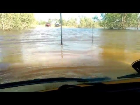Driving A Landcruiser Through A Deep Pond
