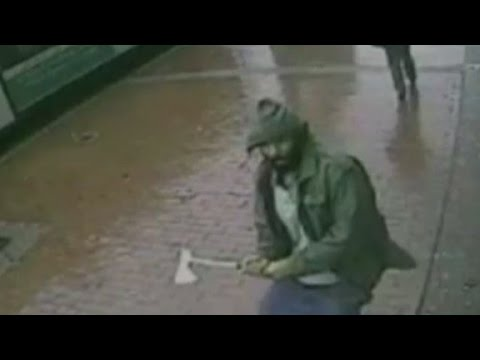 Shows - Surveillance video shows a man charging at four New York Police officers with a hatchet. CNN's Jim Sciutto has more.