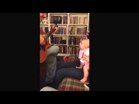 Baby loves the guitar!