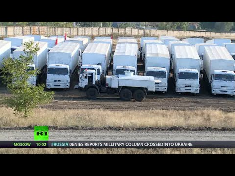 Relief Effort: Russian trucks with tons of goods for E.Ukraine stuck on border