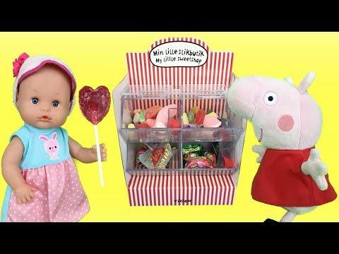 Peppa Pig en español - Peppa pig y bebes nenuco compran dulces, chuches y huevos sorpresa en supermercado.Aventuras Lola