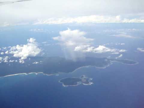 سبحان الله : سحابة تمطر على جزيرة