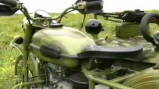 6. Ural sidecar motorbike on rough terrain doing  military maneuvers