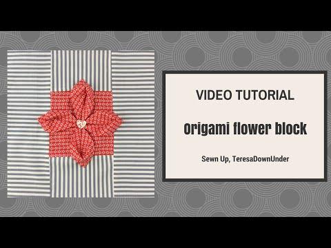 blocco in patchwork con fiore in rilievo