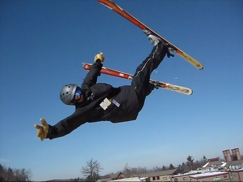 SnowboardSecretsTV - Bo Adams of Mountain Guard Insurance takes his work seriously and launches off the kicker to test the inflatable landing pad at Wachusett Mountain, Princeton...