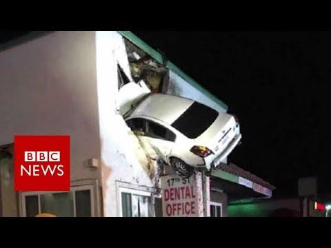 Dashcam captures a Car crashes into building in California - BBC News (видео)