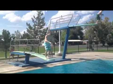 Dan Ellison back-flops during front flip off diving board