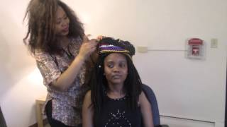 This tutorial shows how Xhosa women tie their heads using the traditional cloth called