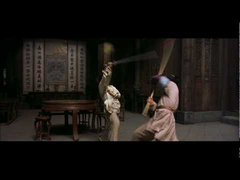 Crouching - Yu Shu Lien (Michelle Yeoh) fights green destiny wielder Jen Yu (Ziyi Zhang) in this movie's trademark fight scene!