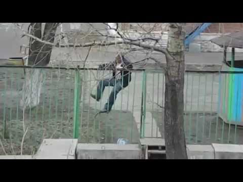 A Man Attempting to Climb a Fence
