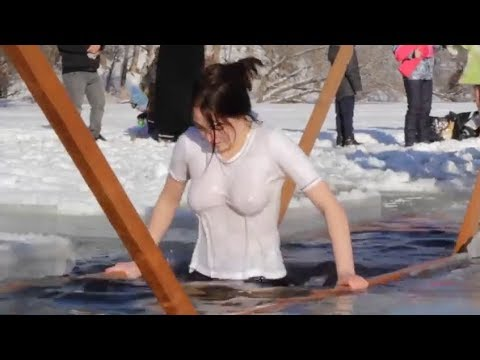 Woman Getting In The Ice Water For Religious Ceremony