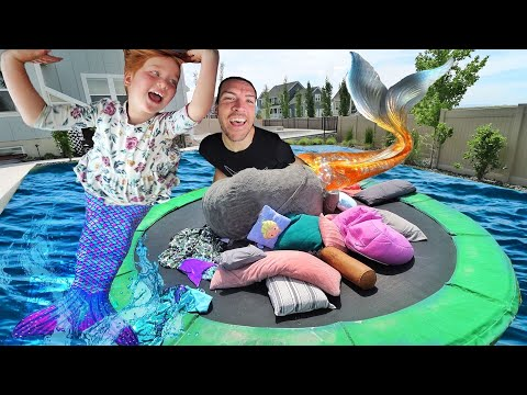 Mermaid PiLLOW FiGHT!!  Adley vs Dad magic trampoline battle with a Giant LoveSac in the Backyard!