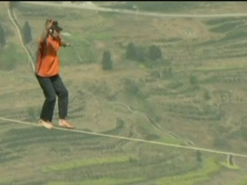 Dean Potter Walks Slackline across Enshi Grand Canyon in China