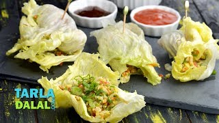 Lettuce Wraps,Recipe Link : https://www.tarladalal.com/Lettuce-Wraps-41902rSubscribe : http://goo.gl/omhUioTarla Dalal App: http://www.tarladalal.com/free-recipe-app.aspxFacebook: http://www.facebook.com/pages/TarlaDalal/207464147348YouTube Channel: http://www.youtube.com/user/TarlaDalalsKitchen/featuredPinterest: http://www.pinterest.com/tarladalal/Google Plus:  https://plus.google.com/107883620848727803776Twitter: https://twitter.com/Tarla_DalalLettuce WrapsAn idea that's totally out of the ordinary, easy to execute but all set to please... get ready to try out our innovative Lettuce Wraps. A colourful and crunchy assortment of veggies, sautéed lightly and mixed into a stuffing, is wrapped in lettuce leaves lined with a herby plum sauce and pungent garlic sauce. A sprinkling of spring onions adds to the taste and textural aspects of this unusual Lettuce Wrap making it an experience that denotes excitement in every dimension. Using sesame oil makes these wraps tastier and healthier too.Preparation Time:  25 minutes.Cooking Time: 6 minutes.Makes 14 wraps. For the vegetable stuffing ½ cup finely chopped carrot½ cup finely chopped baby corn 5 tbsp finely chopped French beans¾ cup finely chopped cabbage1 tbsp sesame oil A pinch of baking soda ½ tsp green chilli pasteSalt to taste¼ cup finely chopped bean sprouts 2 tbsp roasted and powdered peanuts 2 tbsp pinenuts To be mixed into a sauce2 tbsp readymade plum sauce¼ tsp dried thyme¼ tsp dried parsley Other ingredients 14 Iceberg lettuce leaves 3½ tsp red garlic sauce 7 tbsp finely chopped spring onion greens For the vegetable stuffing 1. Heat the sesame oil in a broad non-stick pan, add the carrot, baby corn, French beans, cabbage and baking soda and sauté on a medium flame for 1 to 2 minutes. 2. Add the green chilli paste and salt and sauté on a medium flame for 2 to 3 minutes. 3. Add the bean sprouts and sauté on a medium flame for 10 seconds. 4. Switch off the flame, add the peanuts and pinenuts and mix well. Keep as