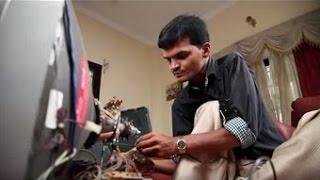 Self-employed TV mechanic on wheelchair