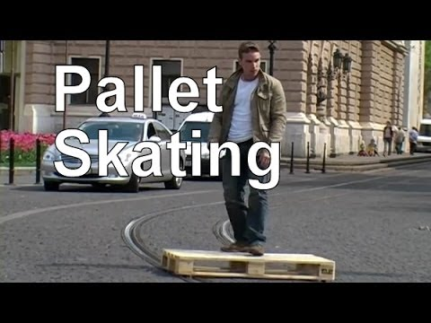 Skating on a Shipping Pallet That Is Modified to Run on Street Car