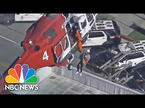Watch Firefighters Rescue Residents From Roof Of Burning High-Rise | NBC News