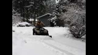 8. snow plow on suzuki king quad