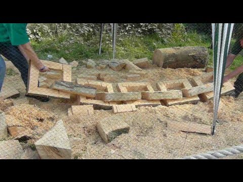 Chainsaw sculpture - making a link chain from a single log