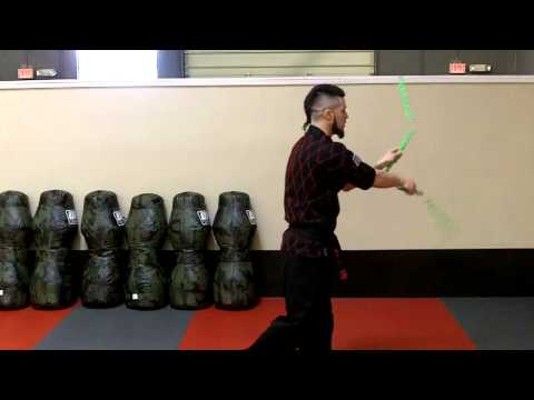 nunchaku - Master Lee demonstrates several nunchaku tricks used in the Double Nunchaku forms.