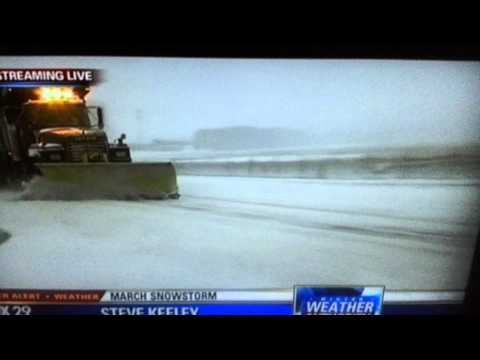 Snow Plow Takes Out Reporter