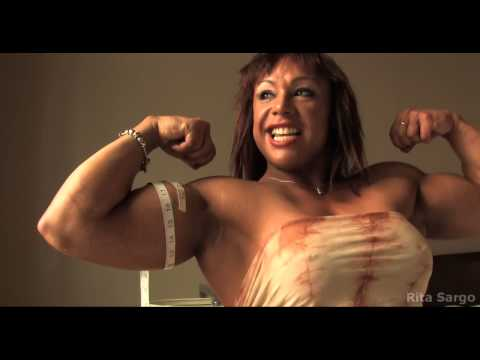 Strong Muscle Woman measuring her 16 inch powerful biceps