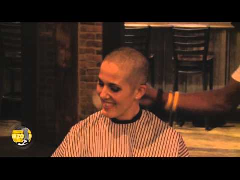 Jayni Angeli, who is battling cancer, shaved her head Wednesday night ahead of racing in the 5k of the Kalamazoo Marathon