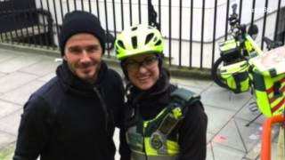 David Beckham helps a cycling paramedic and elderly patient
