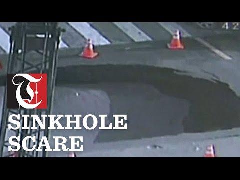 Surveillance video shows a sinkhole appearing