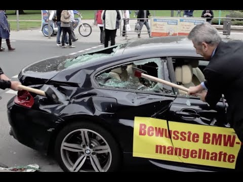 Men express frustration with BMW by destroying car at Frankfort Motor Show