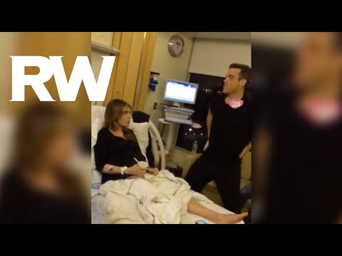 Robbie Williams' wife, Ayda, is currently going through labour, and he's doing his best to help.