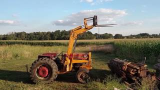 Since I finally have a good loader on the tractor, I built a forklift attachment.   Now I can pick up and move stuff!